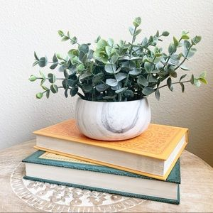 Small faux plant in marble planter